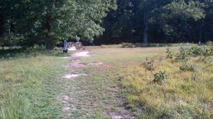 up the hill to the left of the East Angle breastworks. Probably close to the point where the Federals first broke over the line. To the left of Carter's battery going into position.